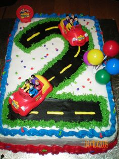 Wiggles Cake this was for twins' 2nd birthday. i ordered the wiggles cars off of ebay than i made the number 2 into a road for the...