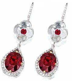 Earrings from: SPINEL AND DIAMOND RING AND PAIR OF MATCHING PENDENT EARRINGS       Accompanied by GRS reports numbered GRS2011-062087, GRS2011-062086 and GRS2011-062085, dated 28 June 2011, stating that the 10.45, 4.74 and 4.84 carat spinels are natural, of Burmese (Myanmar) origin, with no indication of treatments. Sotheby's.