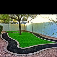 I like the idea of a tree in the middle of the sand-pit, surrounded by artificial grass to provide a little shade. Perhaps an ornamental pear, or maybe an evergreen of some sort.