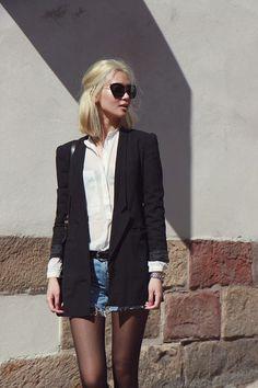 Fall / Winter - street chic style - white chiffon shirt + ragged denim shorts + black belt + black long blazer + black sheer tights + black sunglasses