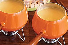 Dip into our delectable Canadian Cheese Fondue!  Made with cheddar cheese and a touch of white wine, this fool-proof fondue recipe is perfect for entertaining.  Serve this fondue with baguette slices, veggie dippers and crisp apple wedges at your next get-together.