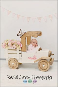 Children's Portraits / Infant / Newborn / Baby Girl / Flowers / Spring / Antique Truck / Wooden Props / Rachel Larson Photography