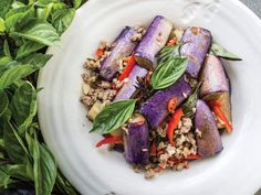 Deep-frying the eggplant ever-so-briefly helps to brighten its lovely purple skin colour. As seen in Pailin Chongchitnant's Eggplant Stir-Fry with Thai Basil (Pad Makeua Yao) from Hot Thai Kitchen.