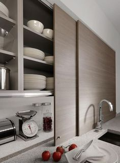 Storage Ideas to Steal from High-End Kitchen Systems Thin sliding cabinet doors in a kitchen by Germany company Beeck Kuchen conceal countertop clutter. Best Kitchen Cabinets, Kitchen Tops, Kitchen Cabinet Design, Modern Kitchen Design, Kitchen Cabinet Doors, Kitchen Interior, New Kitchen, Kitchen Storage, Kitchen Decor