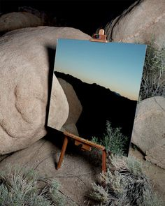 Beautiful landscapes reflected in strategically placed mirrors look like photo realistic artworks painted on canvas.