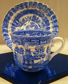 Gold banded , blue willow transferware cup and saucer . Offered by vendor 123 for $8.00