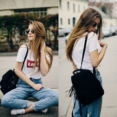 Get this look: http://lb.nu/look/8119254  More looks by Valerie Staber: http://lb.nu/valeriestaber  Items in this look:  Levi's® Shirt, Converse Sneakers, Lost Ink Mom Jeans, Brandy Melville Usa Backpack, Ray Ban Sunglasses   #casual #sporty #vintage