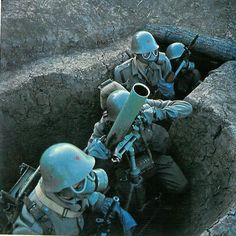 Yugoslav People's Army (JNA) mortar crew training for chemical/biological warfare.