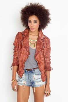 awsome tan leather jacket that would be chic with a fringe crop top, light jean shorts, and gold edgy rings and bracelets