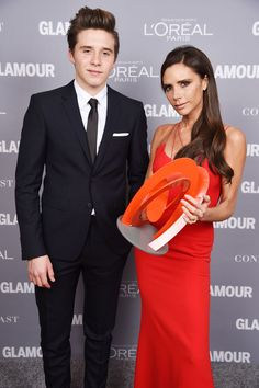 Brooklyn Beckham Photos Photos - Brooklyn Beckham (L) and designer Victoria Beckham pose backstage with her award at the 2015 Glamour Women Of The Year Awards at Carnegie Hall on November 9, 2015 in New York City. - 2015 Glamour Women of the Year Awards - Backstage
