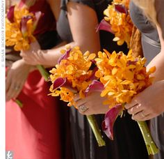 The bridesmaids carried hand-tied bouquets of burnt orange Mokara orchids and red calla lilies.