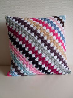 Love this crocheted pillow with grayastlknny stripes on an angle