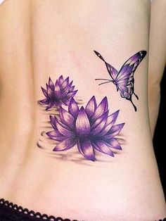 lotus tattoos for women | purple lotus flower with butterfly tattoo