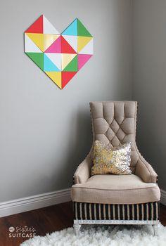 Geometric heart wall treatment made of triangles. I like that pillow too!