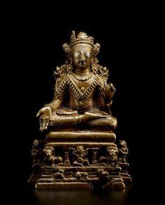 A silver and copper inlaid copper alloy figure of Buddha Kashmiri, circa 8th century