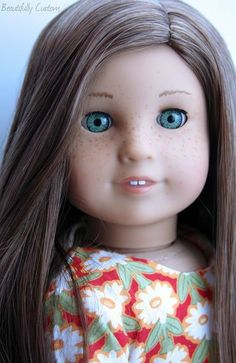 Classic mold, Caroline eyes, brown hair and hand painted freckles.