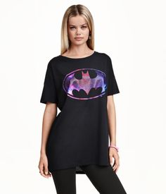Long T-shirt with a printed design. Slightly longer back section with rounded hem.
