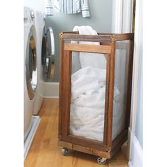 Awesome laundry hamper must do this and wheels added make this beyond great. Also frosting the glass would make a good way to hide that it's full of dirty clothes