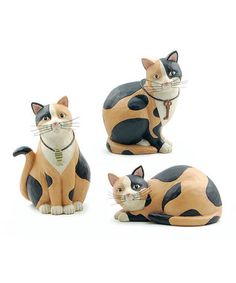 Calico cat figurines designed by Robin Davis