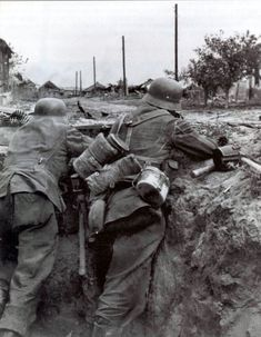 1942 Soviet Union, Stalingrad, Two German soldiers fighting in a city in trench