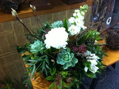 Winter table arrangement @ Newstead flowers