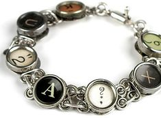 ...a typewriter bracelet. I see pictures of loved ones intermittent with original keys.