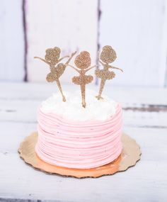 These adorable ballerinas are dancing on the cake! This set of 3 ballerinas makes for one special cake topper. Or, order multiple sets to use as cupcake toppers! These are available in glitter as show