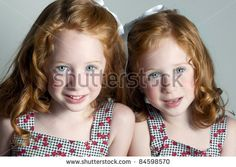 Twin little girls with red hair and blue eyes by Parris Blue Productions, via ShutterStock