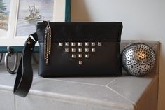 """""""Stomp!"""" is my newest Clutch-Let!  Soft leather look vinyl with faux suede snakeskin accents, pyramid shaped nail heads and a cool square link chain zipper pull!  Find Bobbin My Thread on Facebook to see my other designs!"""
