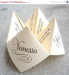 """Wedding cootie catcher!  If this were true-to-elementary-school, this is how it'd go: """"Ok, how about blue?""""  """"B-L-U-E. Ok, it says...YOU'RE UGLY."""""""