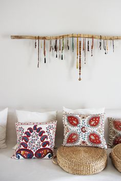 Are those Buddhist prayer malas hanging on that branch as art? Pillows are gorgeous; Suzani embroidered silk Jewelry Organizer Wall, Jewelry Storage, Jewelry Organization, Display Ideas, Storage Ideas, 21st, Jewelry Design, Throw Pillows, Room