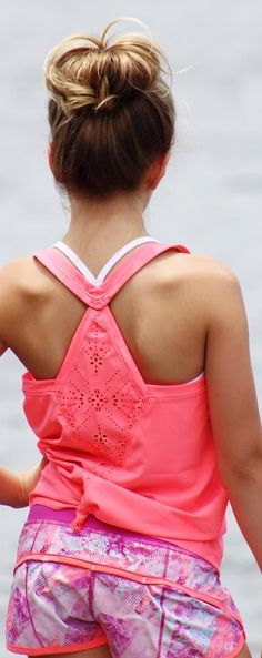 Tie up this laser cut tank for a snug fit at the hip.   Fast Beat Singlet