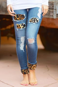 I need these. Slightly distressed skinny jeans with sassy leopard patches. Roll them up to expose a fierce leopard accent on the cuff. Single button, high waisted, 5 pockets.
