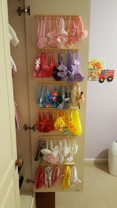 Here I used hooks into strips of wood and attached to inside the wardrobe, perfect for headboard storage #babyheadbands Here I used hooks into strips of wood and attached to inside the wardrobe, perfect for headboard storage