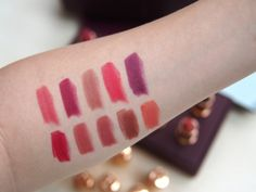 Charlotte Tilbury's Matte Revolution Lipstick swatches: Top Row: Amazing Grace, Love Liberty, Very Victoria, Lost Cherry, Glaston-Berry Bottom Row: Red Carpet Red, Walk of Shame, Bond Girl. Birkin Brown, Sexy Sienna