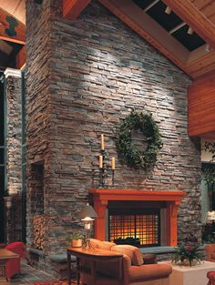 love the floor to ceiling fire place with stone