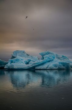 Ice Rocks at Jokulsarlon - Jokulsarlon is a large glacial lake in southeast Iceland, on the edge of Vatnajokull National Park. During the day it is usually packed with visitors but I was able to spend alone time there at around 23.00 in the evening and get this rather moody colorful shot.  If you want to visit Jokulsarslon and other places in Iceland, send me a message on Facebook or email me at dagur@libius.is.  If you like my work you can follow me on Facebook <a…