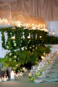 Structure made of greenery, white flowers with a cage filled with candles on top Italy Wedding, White Flowers, Cage, Greenery, Floral Design, Candles, Table Decorations, Weddings, Top