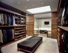 Most amazing closet/bathroom ever. The wood, the bench in the middle. Miraculous.