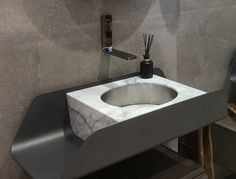 Marble stone basin inset in metal fabricated matt grey unit