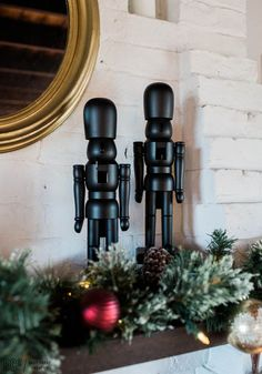 chic and simple modern minimalist christmas and holiday decor love the all black nutcrackers on the mantle