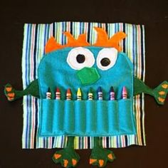 Monster craft bag for kids activity bag. I like the crayon teeth. Made as goodie bags for the monster birthday.