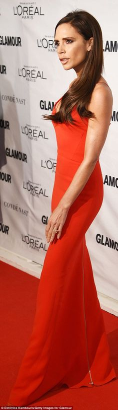 Lady in red: Victoria vamped it up in a dramatic cherry gown featuring spaghetti straps as well as matching crimson heels