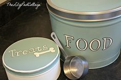 Popcorn or ugly cookie tins re-purposed storage for just about anything.  Note to self:look for square ones