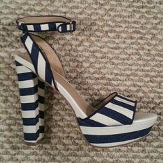 Just Fab blue and offwhite striped platforms Just Fab blue and offwhite striped platforms.  Heels are almost six inches and platform is almost 1 1/2 inches.  Never worn, only tried on.  Size 8.5 JustFab Shoes Platforms