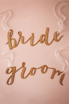 Wooden Bride and Groom Chair Signs from @BHLDN