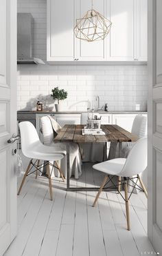 What's not to love about this dining room/kitchen combo? There's a clean white kitchen, a gorgeous reclaimed wood table, & a unique chandelier! Sounds like a winner to me.
