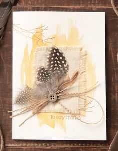 These boho cards by Ava Gavloski use shimmery spray inks brushed on in long dramatic strokes to create color behind her layered ephemera.