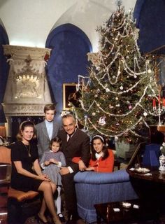 A family photo at the holidays:  Grace in her short sleeved black sheath, the Prince, & their three children, Caroline, Albert & Stephanie.