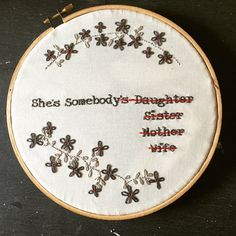 She's Somebody Embroidery, birthday gift, feminism, gray, red, flowers, feminist, embroidery hoop, hoop art, hand embroidery by PrintingByProxy on Etsy https://www.etsy.com/transaction/1209741353